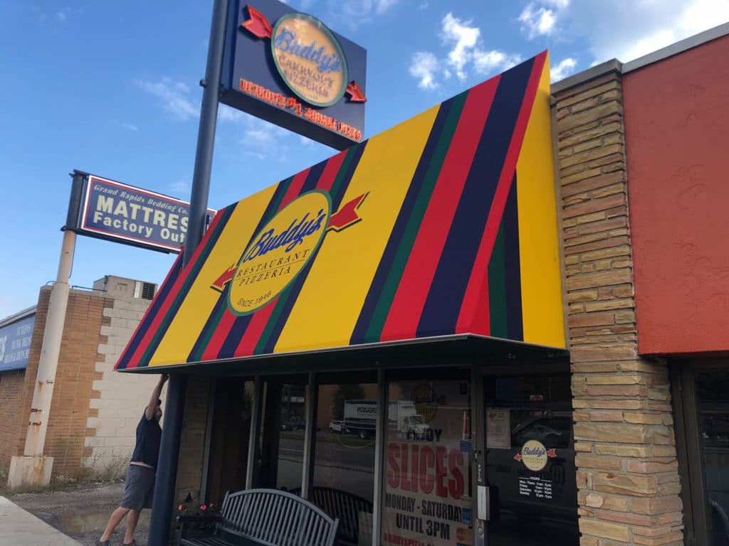 Commercial awning companies - pizzaria awning - Buddy's Pizza - Marygrove Awnings
