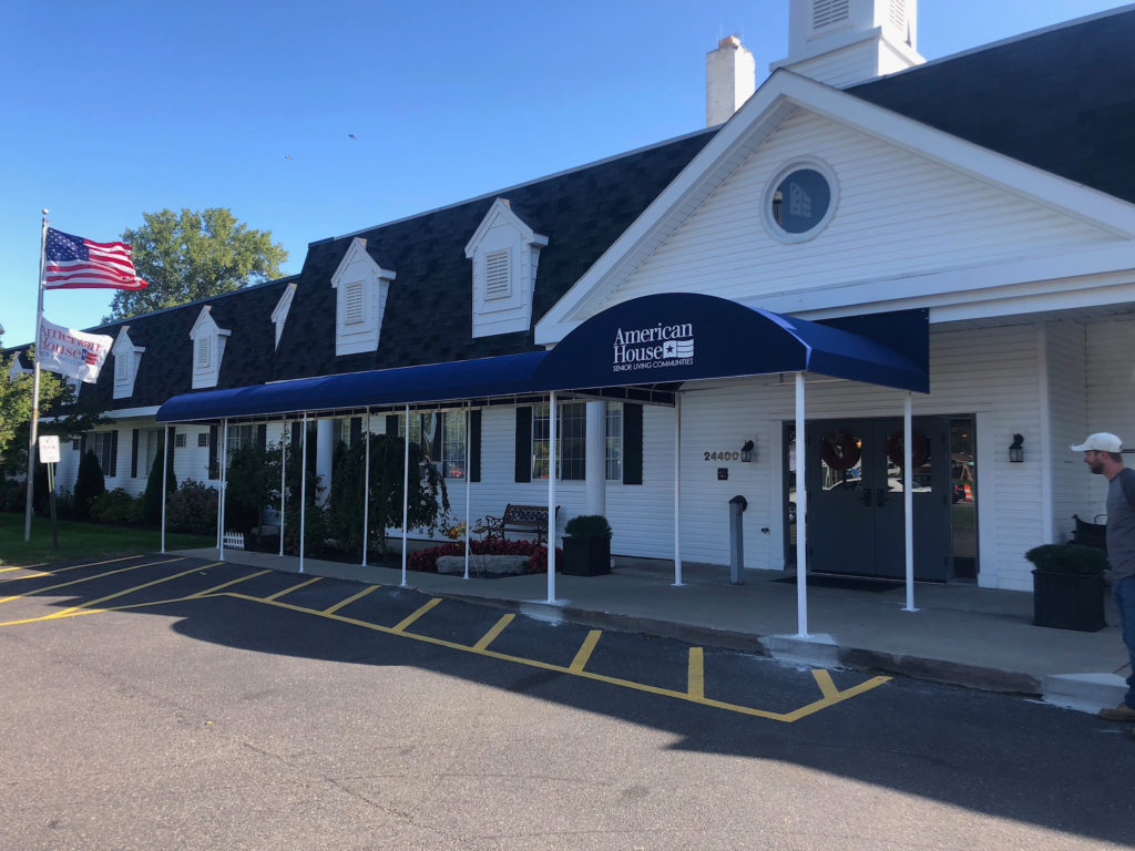 Awning signs for business - metal frame awning with canvas cover - American House Senior Living Communities - Marygrove Awnings