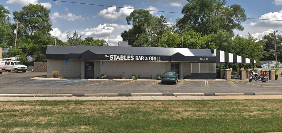 Custom commercial awnings - storefront awning with outdoor seating awning - The Stables Bar & Grill - Marygrove Awnings